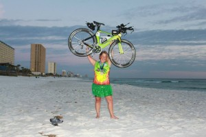 Laura Backus on beach with bike